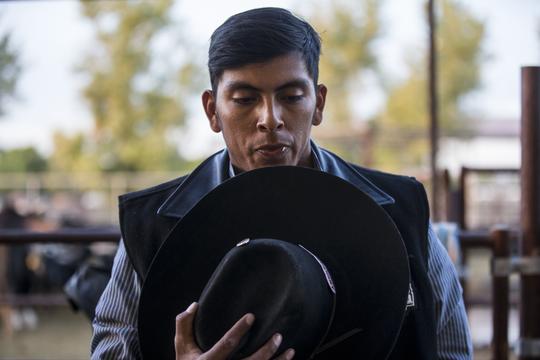 Jalen Joaquin prays during the Gilbert Days Rodeo on Saturday, Nov. 17, 2018, in Gilbert, Ariz.