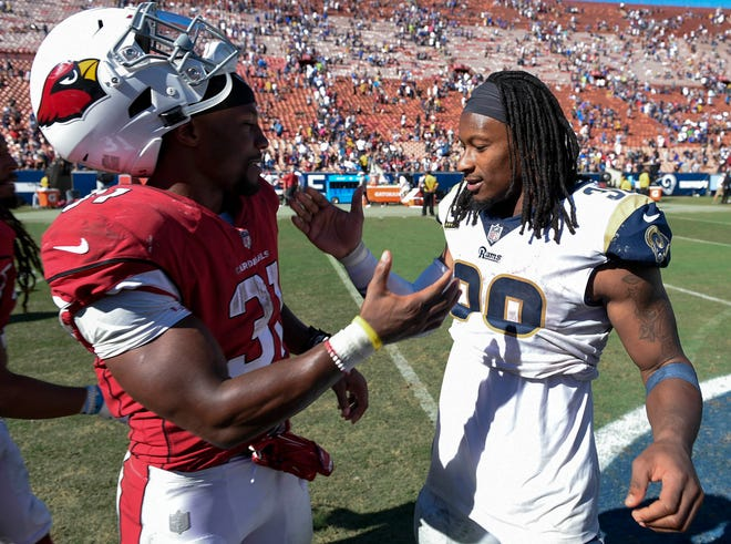 Los Angeles Rams running back Todd Gurley II (right) and Arizona Cardinals running back David Johnson (31) are two of the best running backs in the game.