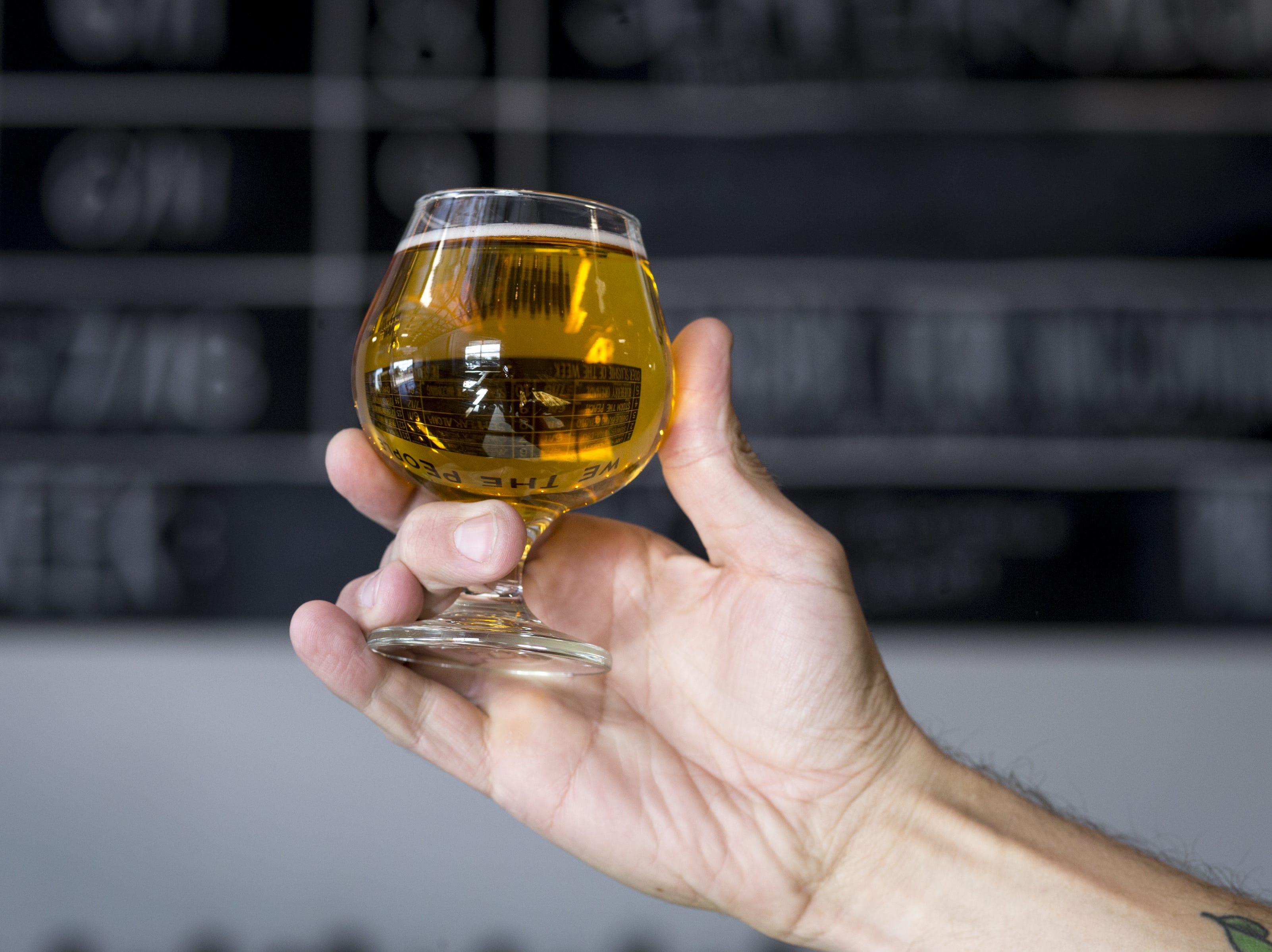 Josh Duren holds a cider, Dec. 5, 2018, at Cider Corps, 31 S. Robson, Mesa.