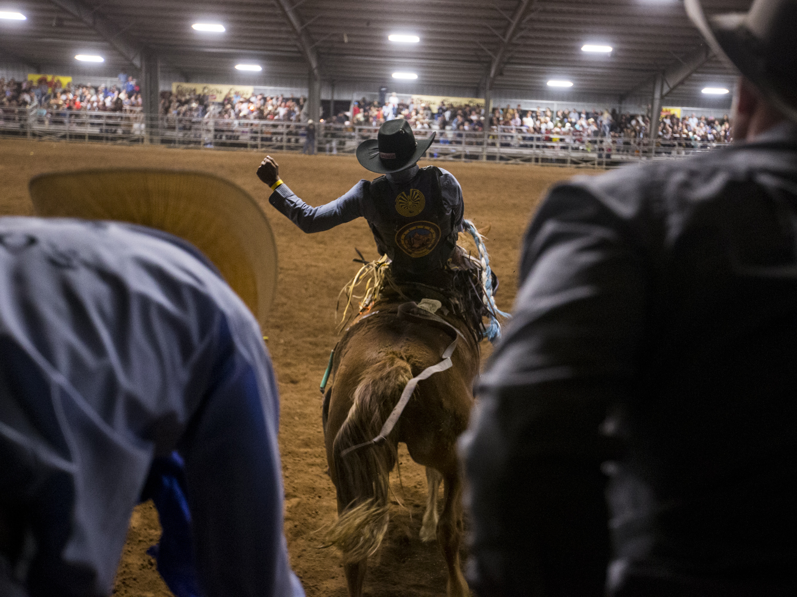 Jalen Joaquin rides a bronco during the Gilbert Days Rodeo on Saturday, Nov. 17, 2018 in Gilbert, Ariz.