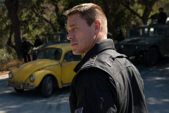 "Agent Burns (John Cena) thinks something unusual is going on in ""Bumblebee."""