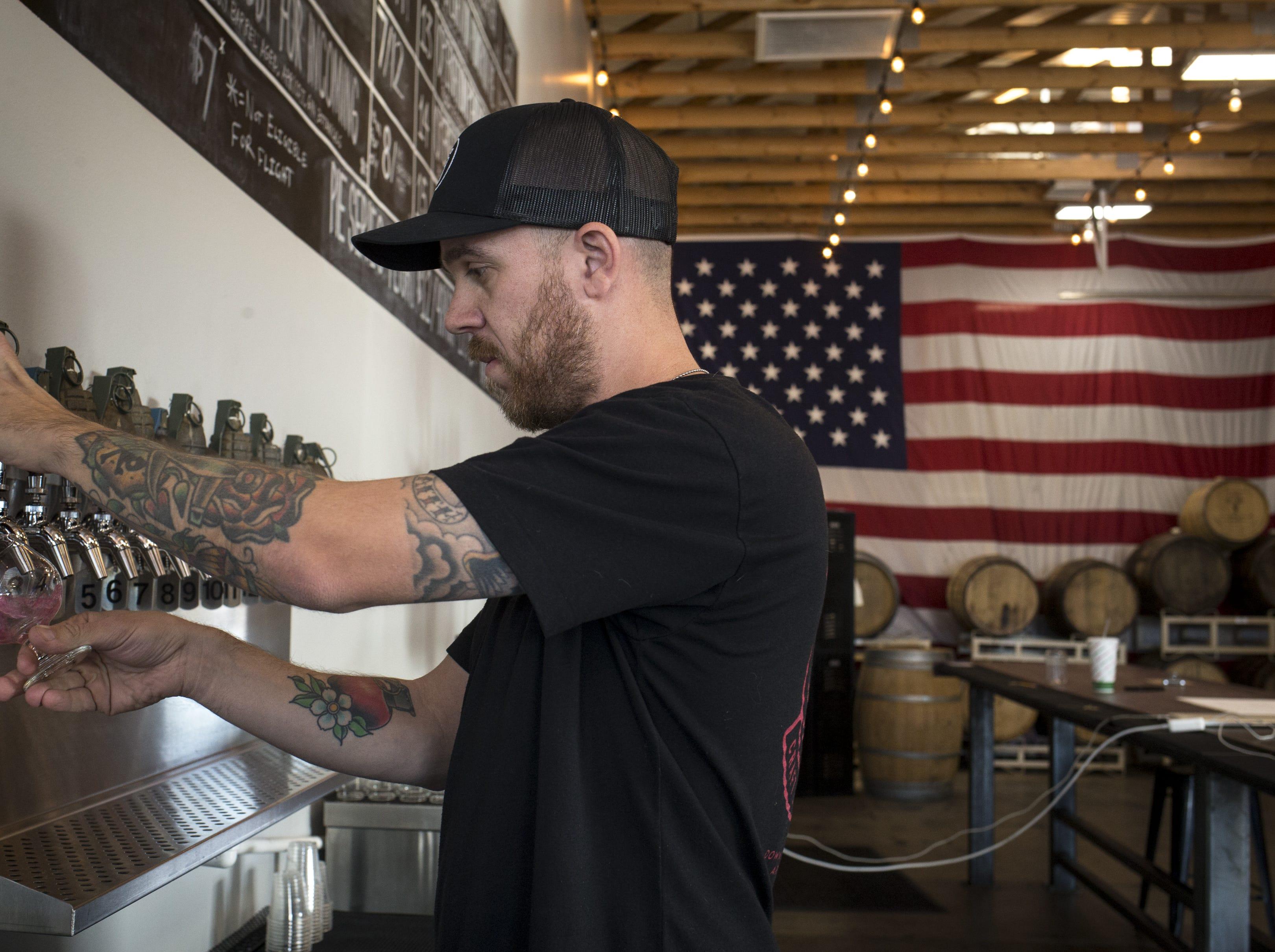 Josh Duren draws a cider, Dec. 5, 2018, at Cider Corps, 31 S. Robson, Mesa.