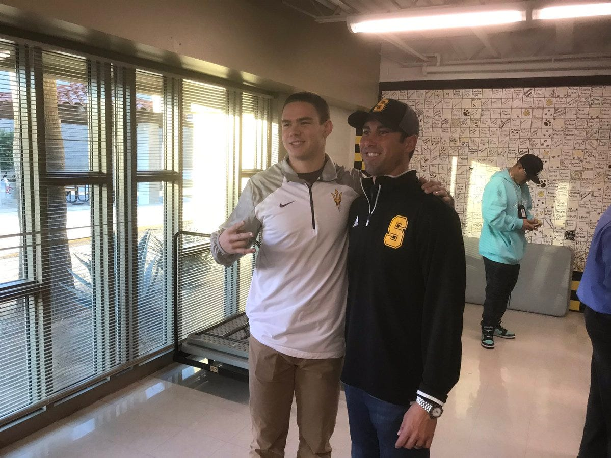 Saguaro hybrid linebacker Connor Soelle with coach Jason Mohns after signing with ASU on Dec. 19, 2018.