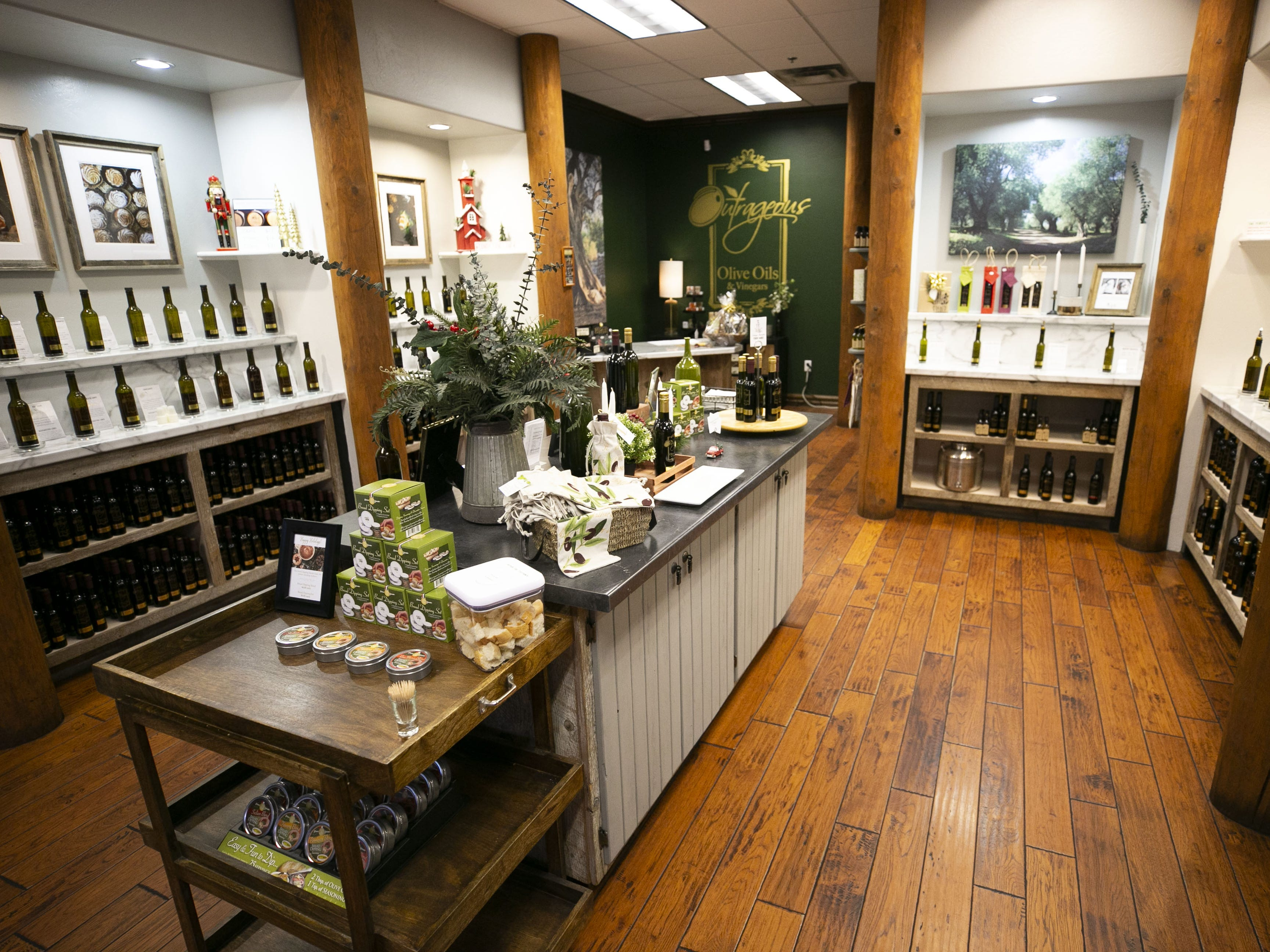 Outrageous Olive Oils & Vinegars in Old Town Scottsdale on Tuesday, Dec. 11, 2018. The shop is owned by former child actor, Frankie Muniz and his fiance Paige Price.