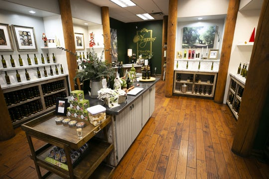 Outrageous Olive Oils & Vinegars in Old Town Scottsdale on Tuesday, Dec. 11, 2018. The shop is owned by actor Frankie Muniz and his fiancee, Paige Price.