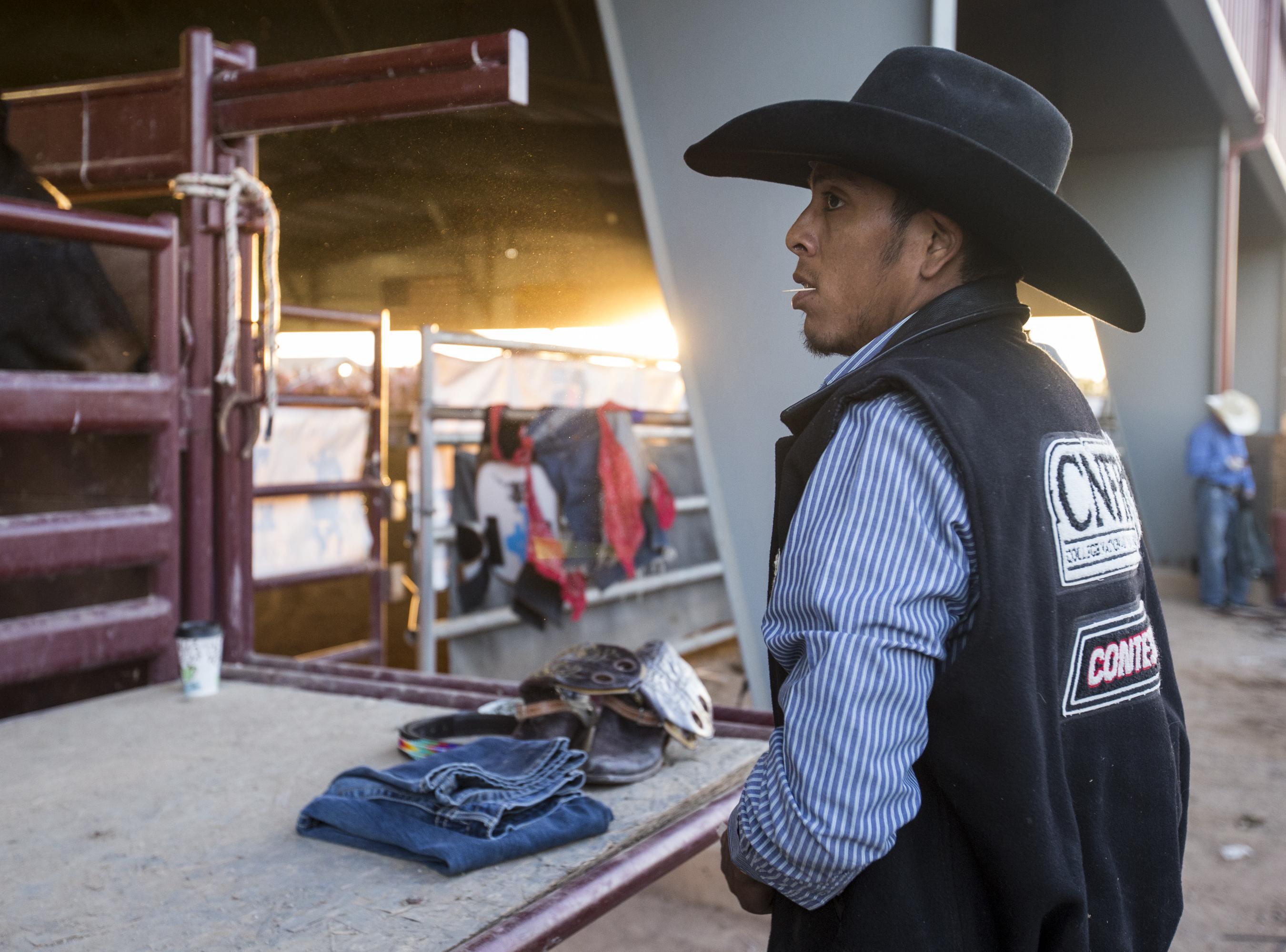 Jalen Joaquin watches the Gilbert Days Rodeo on Saturday, Nov. 17, 2018, in Gilbert, Ariz.