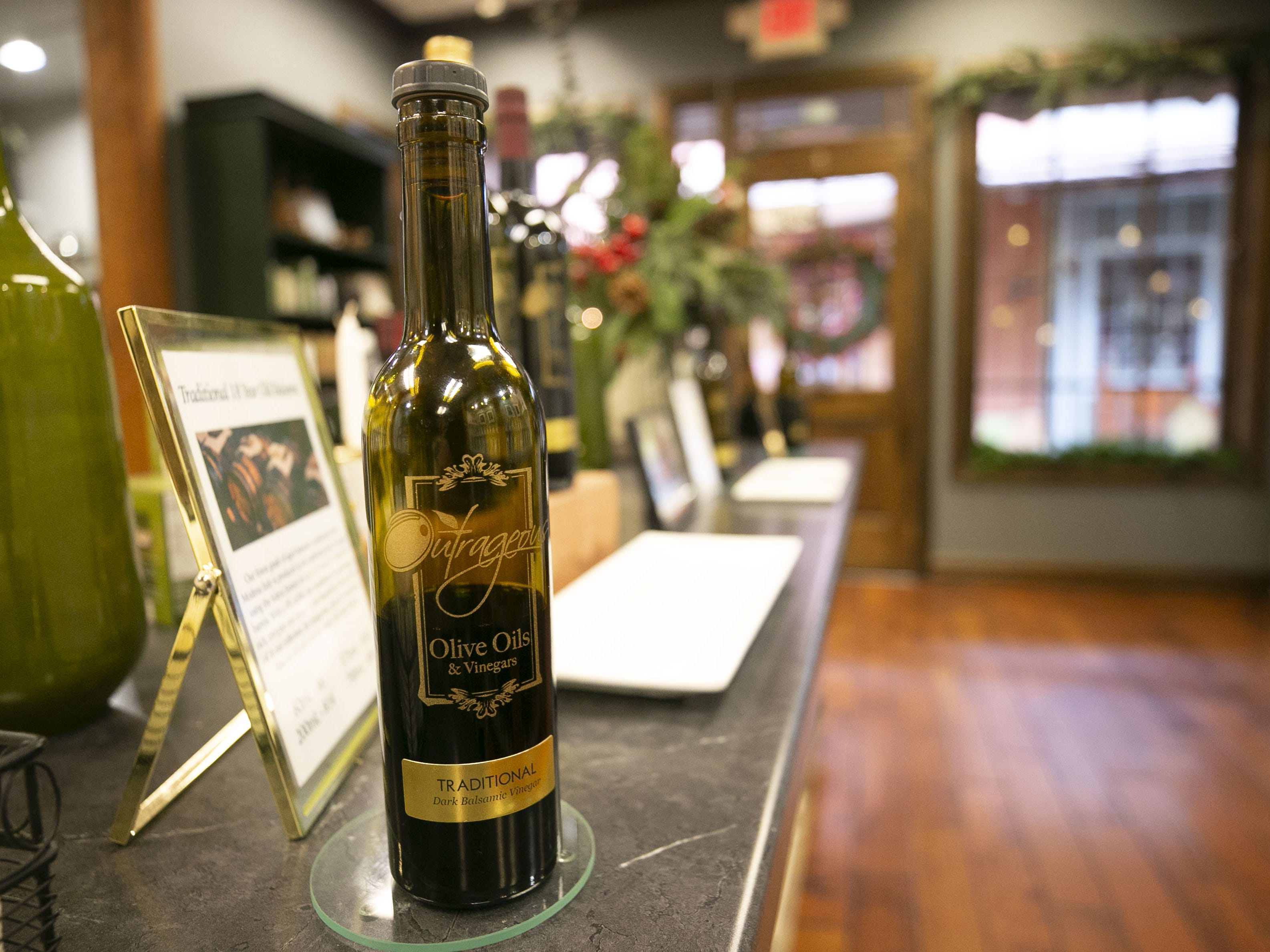 A bottle of dark balsamic vinegar at Outrageous Olive Oils & Vinegars in old town Scottsdale on Tuesday, December 11, 2018. The shop is owned by former child actor, Frankie Muniz and his fiance Paige Price.