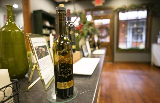 A bottle of dark balsamic vinegar at Outrageous Olive Oils & Vinegars in Old Town Scottsdale on Tuesday, Dec. 11, 2018. The shop is owned by actor Frankie Muniz and his fiancee, Paige Price.