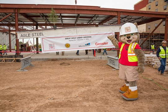 The mascot for Great Wolf Lodges stands outside the future site of the Great Wolf Lodge Arizona.