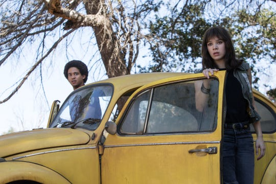 "Memo ( Jorge Lendeborg Jr.) and Charlie (Hailee Steinfeld) have just taken a ride in the title character in ""Bumblebee."""
