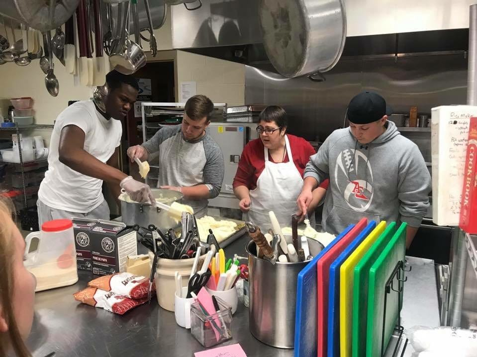 The Annville-Cleona football team recently helped prepare and serve a meal to residents at the Lebanon Rescue Mission.