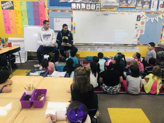 Lebanon High boys basketball players visited elementary schools in the district and read stories to the students during the holiday season.