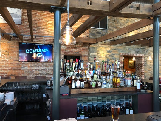 The bar area at Rising Sun gives off a sort of rustic look mixed with a modern, sports bar feel.