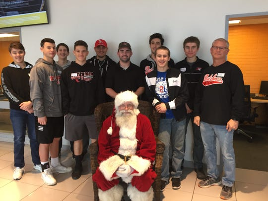 Members of the Annville-Cleona baseball team recently took part in an event sponsored by Klick-Lewis and Caring Cupboard, helping children in need pick out gifts for themselves and family members.
