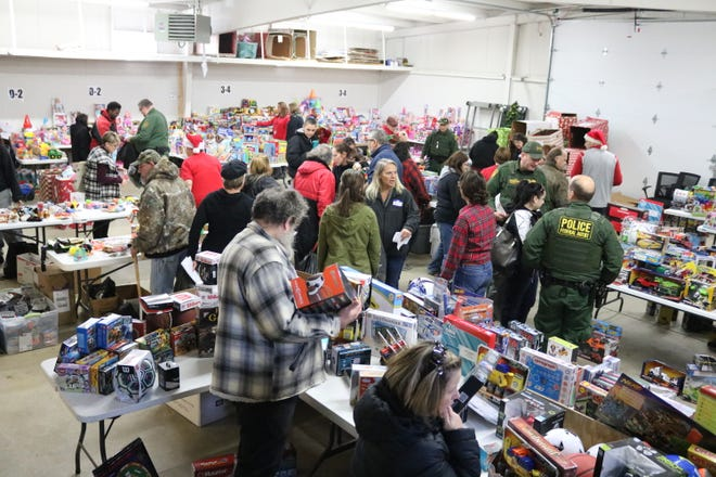 Hundreds of Ottawa County families participated in the local Salvation Army's Toys for Tots program, which held its distribution day on Wednesday.