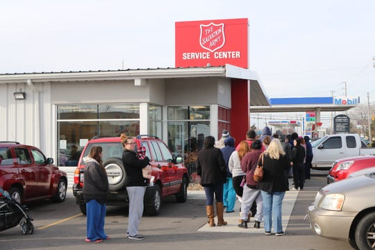 Ottawa County families wait in line outside the local Salvation Army service center to participate in the annual Toys for Tots program, which had its distribution day on Wednesday.