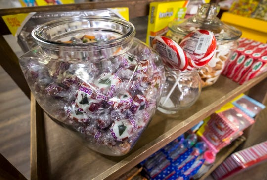 A jar of Christmas Tre Nougat sits in a jar among other Christmas candies at A Little Something in downtown Port Huron. The candy topped this year's  CandyStore.com list of America's least favorite Christmas candy.