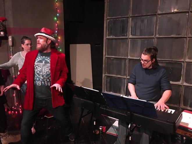 """Ryan McInnis, center, rehearses with Steven Kautz for a performance of the play """"What the Christmas?"""" at The Citadel Stage in Port Huron."""