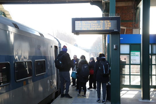 Passengers board a Metro North train at the Poughkeepsie Train Station on December 19, 2018.