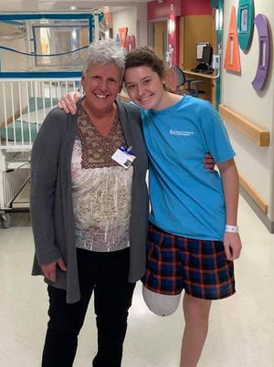 Kylee Long, right, with her grandmother, Tina Long, on Dec. 18 in Children's Hospital of Philadelphia.