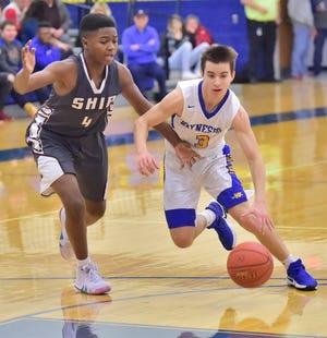 Waynesboro's Cole Rhyne (3) drives to the basket past Jeremy Thomas of Shippensburg on Tuesday, December 18, 2018. Waynesboro defeated Shippensburg 72-59 during a home game.