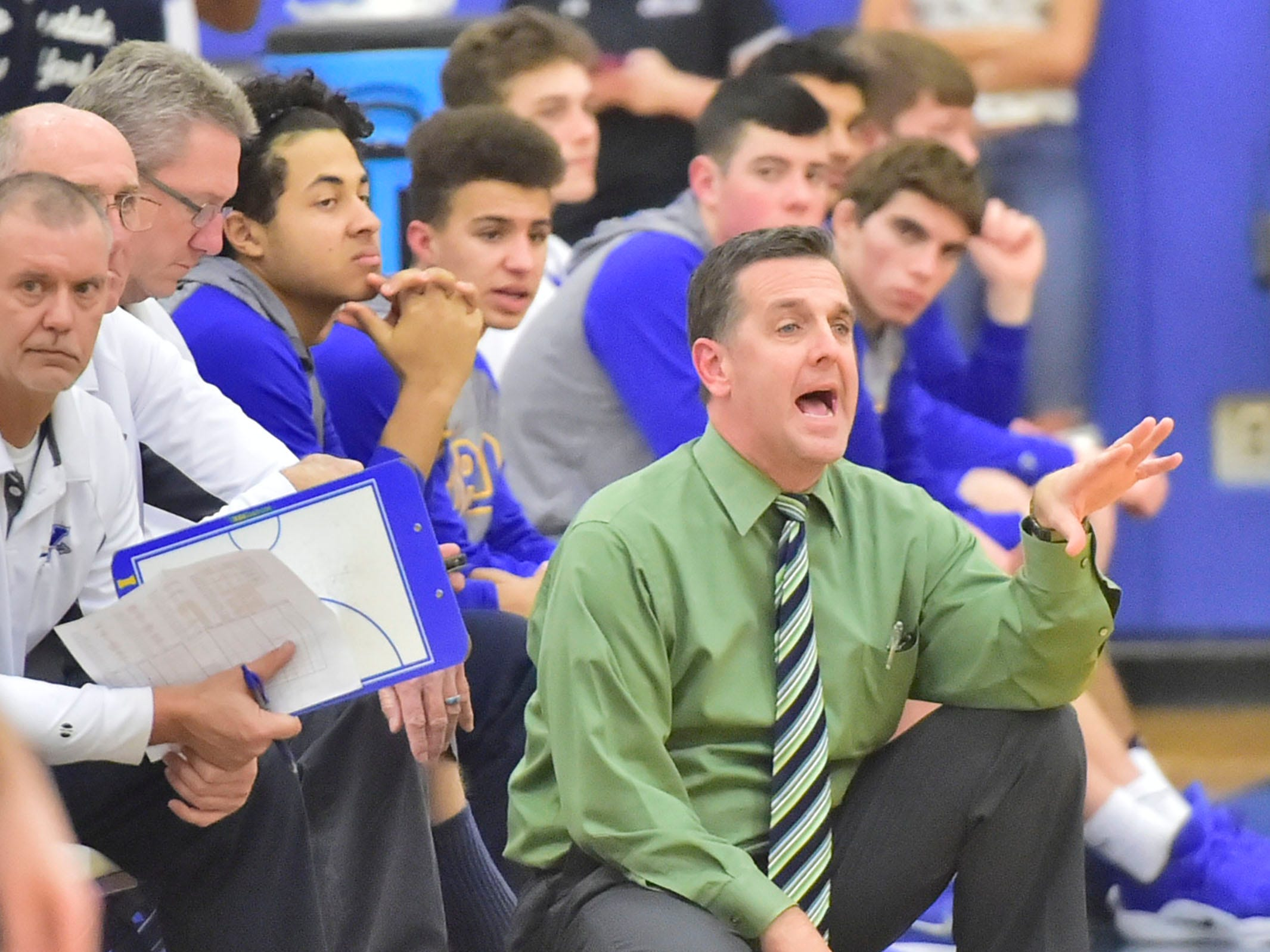 Tom Hoffman coaches the Waynesboro Indians on Tuesday, December 18, 2018. Waynesboro defeated Shippensburg 72-59 during a home game.