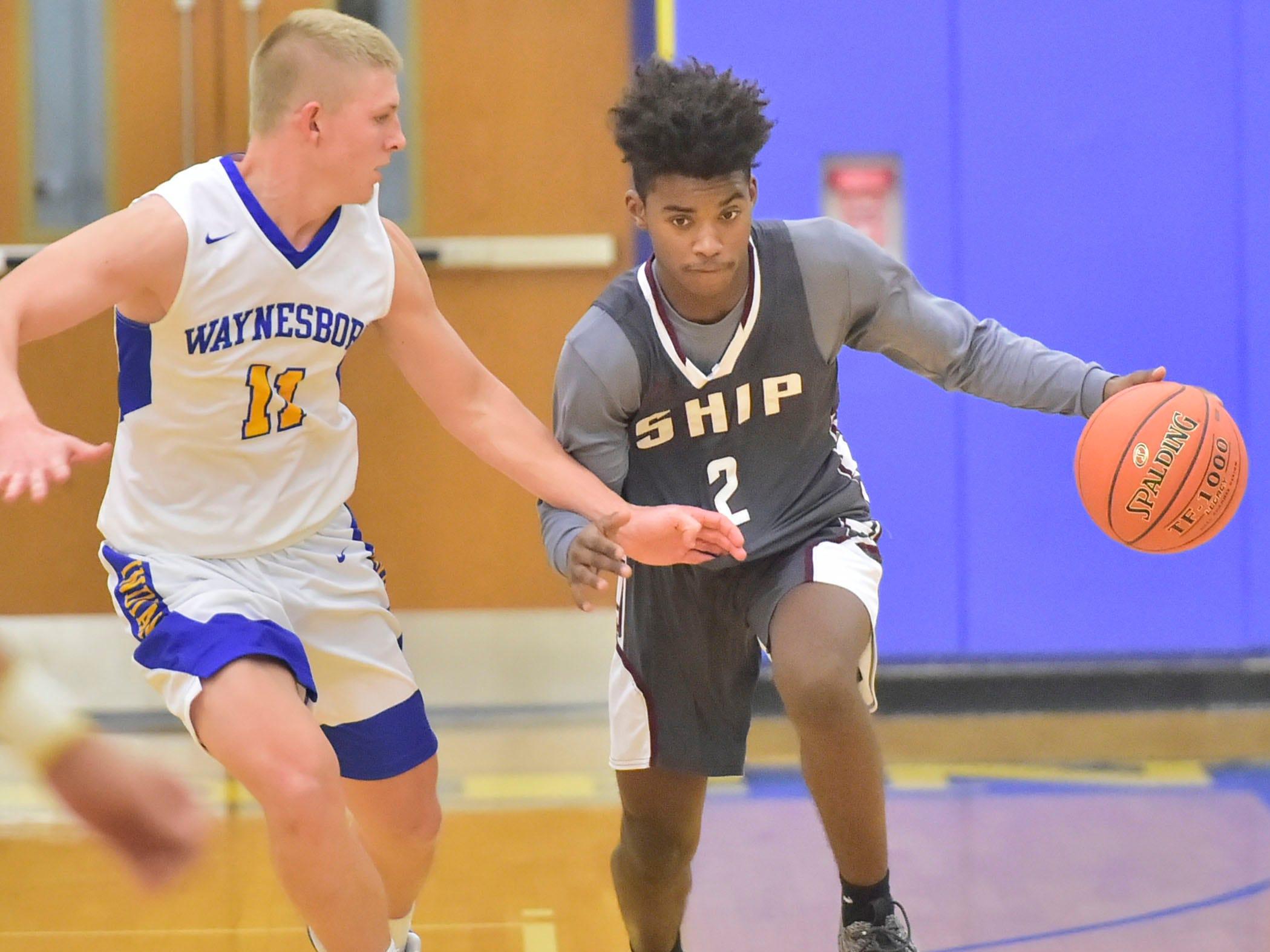 Jayden Statum of Shippensburg dribbles past (2) of Waynesboro's Derek Burhman (11) on Tuesday, December 18, 2018. Waynesboro defeated Shippensburg 72-59 during a home game.
