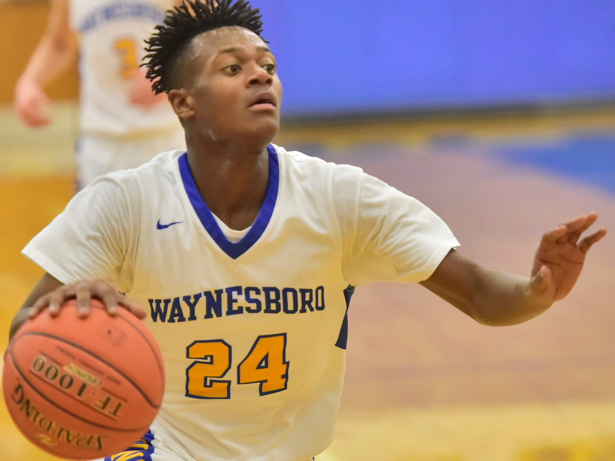 Jerem Brown works the ball inside for the Indians on Tuesday, December 18, 2018. Waynesboro defeated Shippensburg 72-59 during a home game.