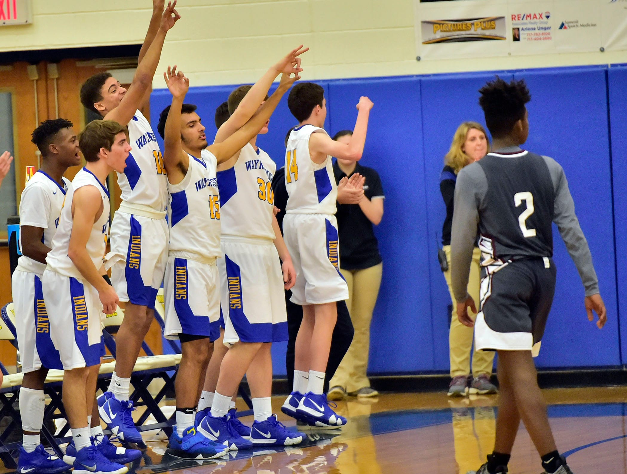 Indians teammates celebrate a score. Waynesboro defeated Shippensburg 72-59 during a home game.