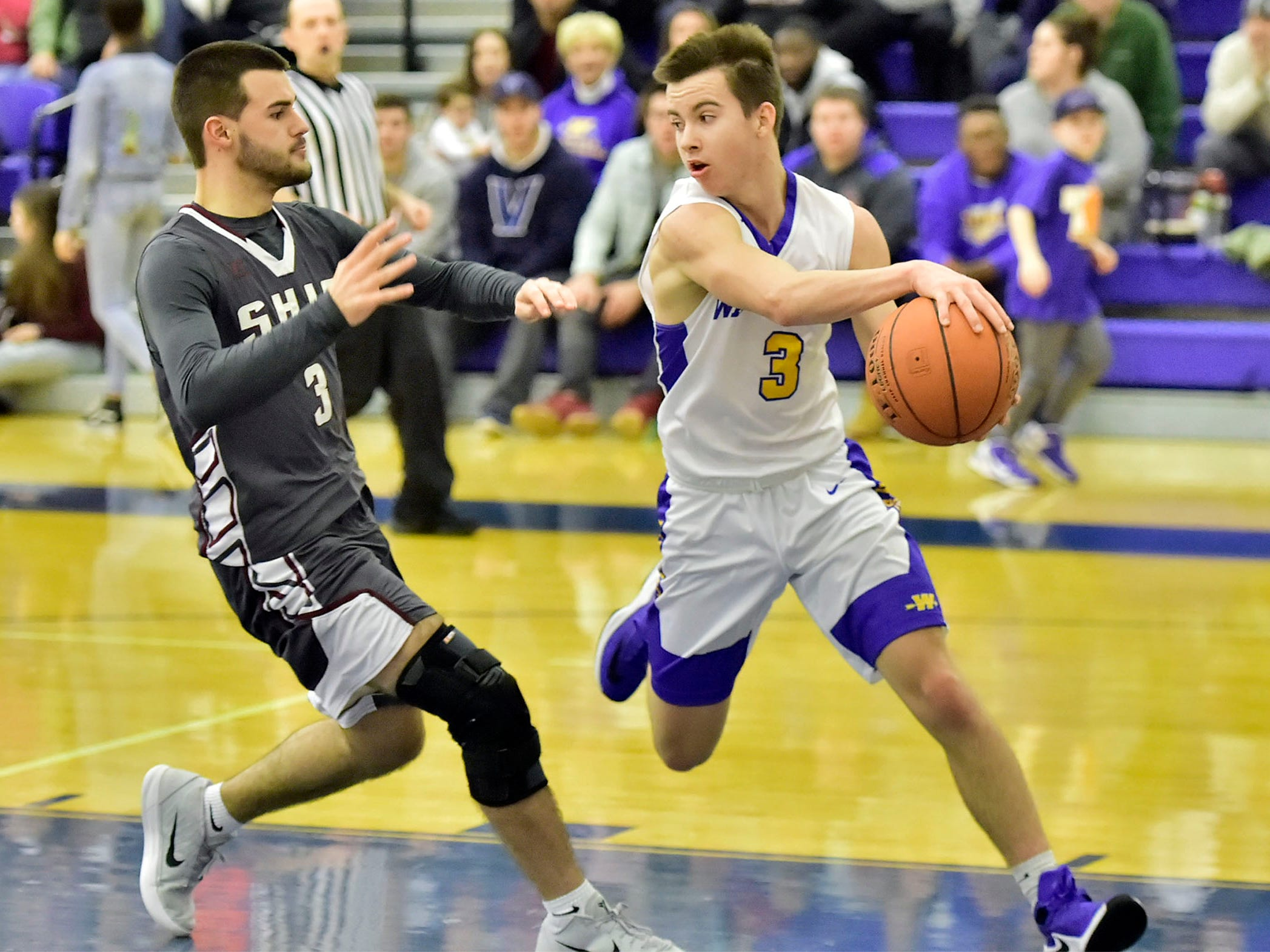 Cole Rhyne of Waynesboro (3) passes the ball around Carson Helflrick Shippensburg's (3) on Tuesday, December 18, 2018. Waynesboro defeated Shippensburg 72-59 during a home game.