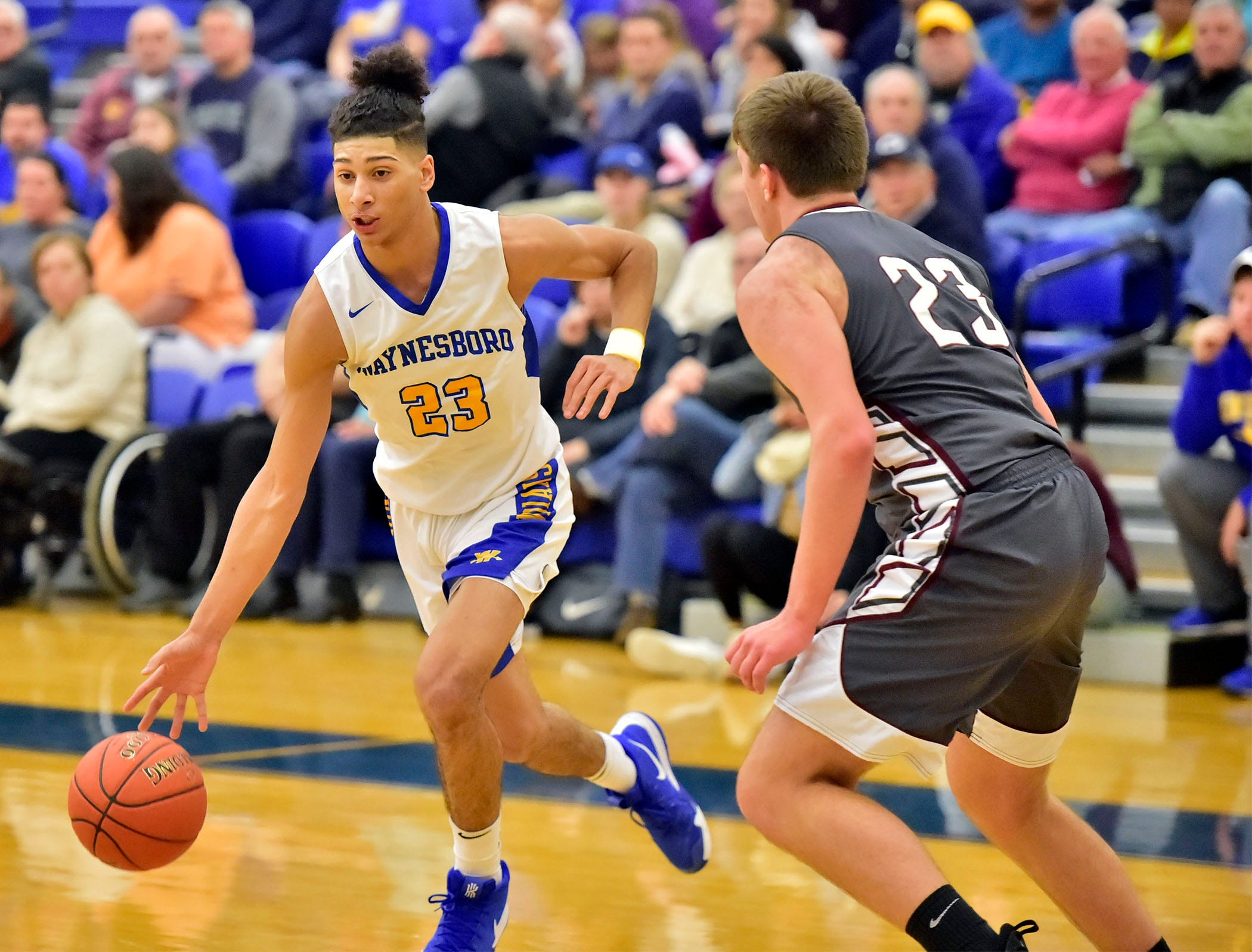 Waynesboro's Jay Alvarez (23) dribbles past Shippensburg's Collin Taylor on Tuesday, December 18, 2018. Waynesboro defeated Shippensburg 72-59 during a home.