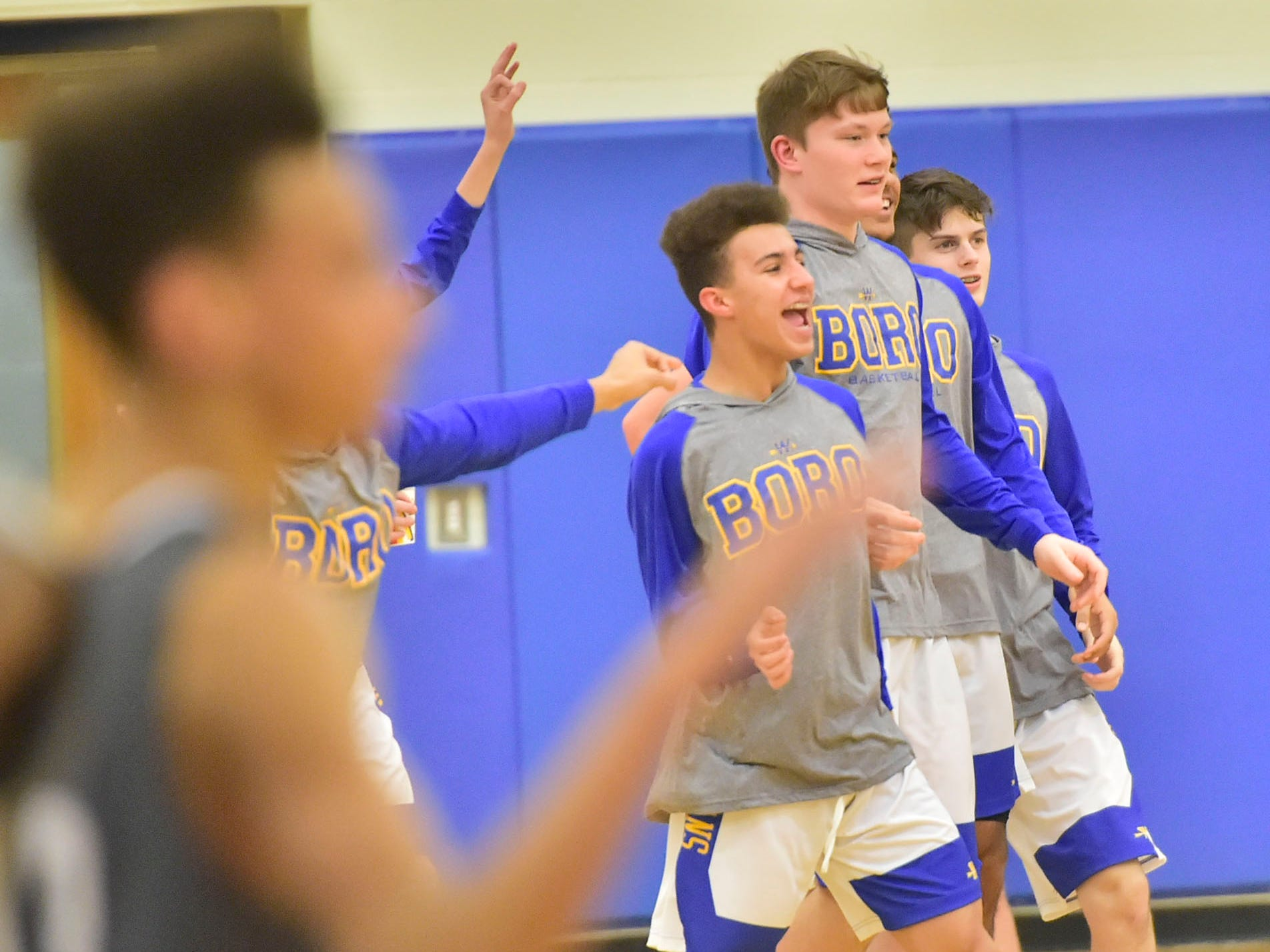 Indian teammates celebrate on Tuesday, December 18, 2018. Waynesboro defeated Shippensburg 72-59 during a home game.
