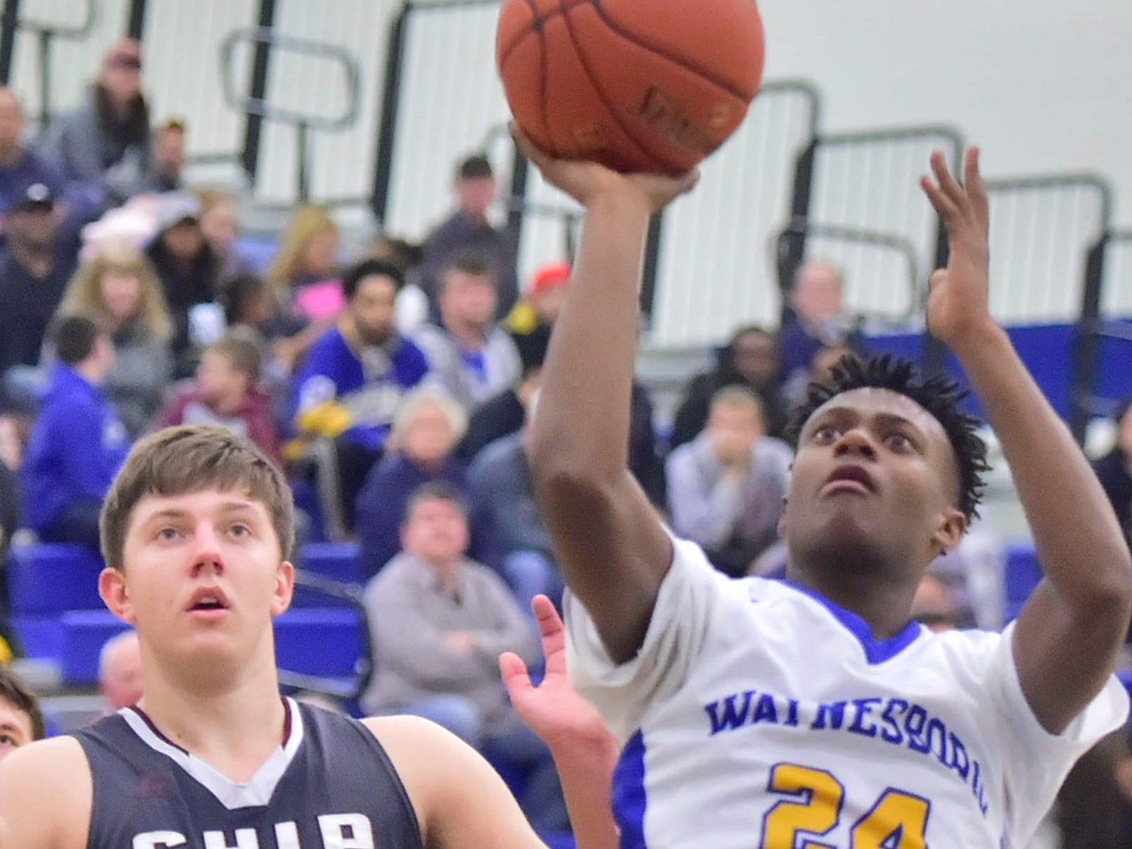 Waynesboro's Jerem Brown (24) shoots on Tuesday, December 18, 2018. Waynesboro defeated Shippensburg 72-59 during a home game.