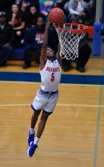 Edward Minter of York High goes airborne for the slam on a break away from Central York, Tuesday, December 18, 2018.