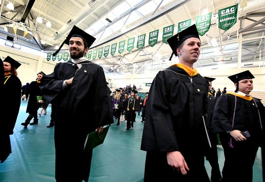 Students, family and friends gather for the York College winter commencement ceremony at Grumbacher Sport and Fitness Center's M&T Field House Wednesday, Dec. 19, 2018. Nearly 300 students graduated during the ceremony. Bill Kalina photo