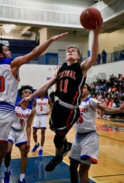 Central York;s Nolan Hubbs drives the lane through a host of York High defenders for a shot at the basketl, Tuesday, December 18, 2018.