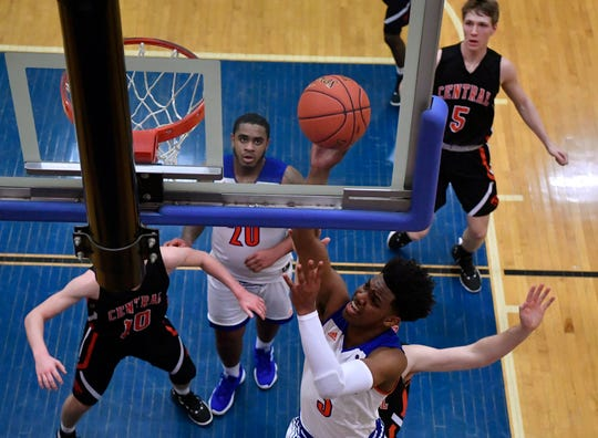 Clovis Gallon Jr. of York High drives the baseline to the basket against Central York, Tuesday, December 18, 2018.