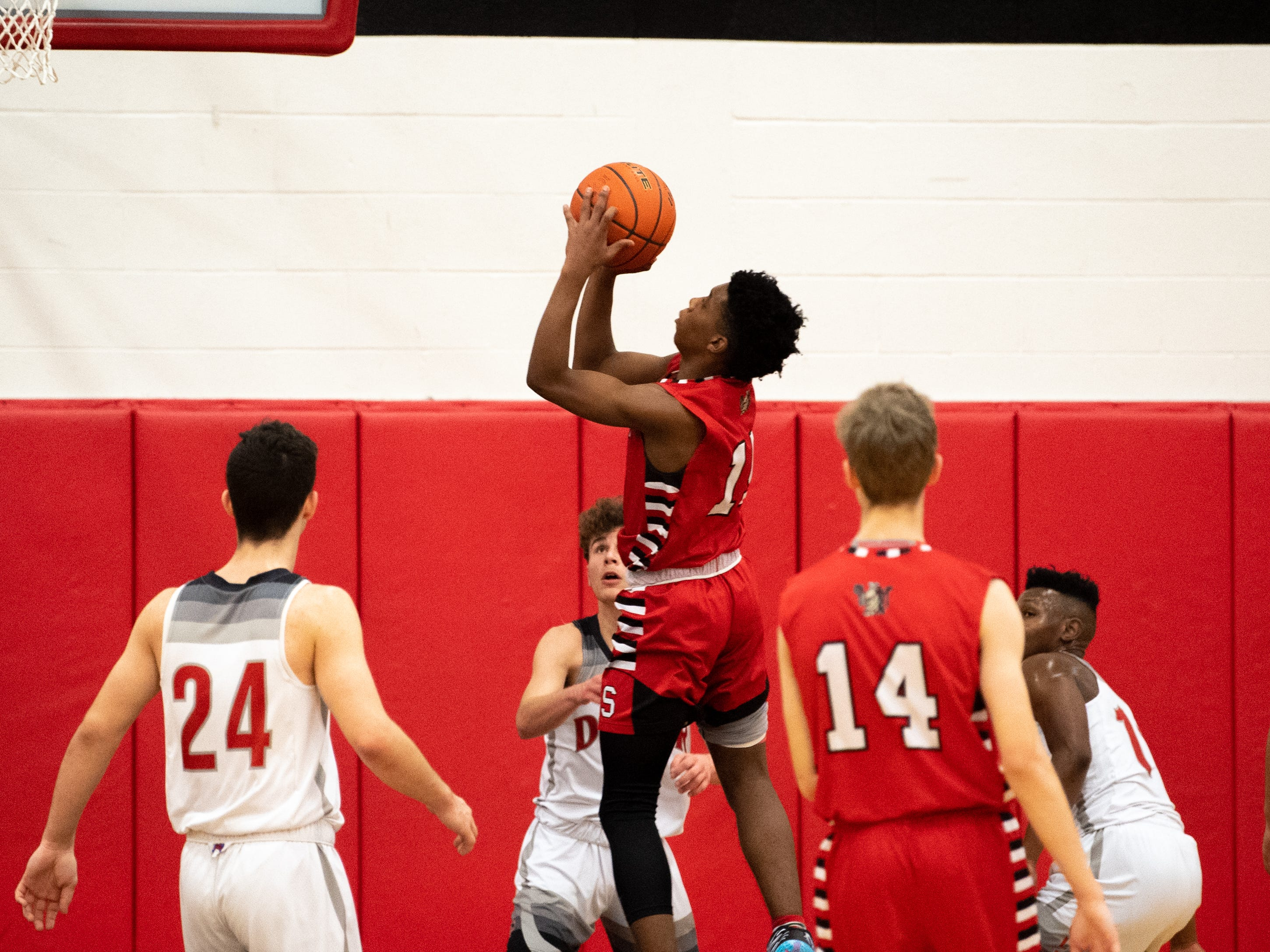 Jalen Franklin (15) goes the basket with authority during the boys' basketball game between Dover and Susquehannock at Dover Area High School, December 18, 2018. The Eagles defeated the Warriors 69-61.