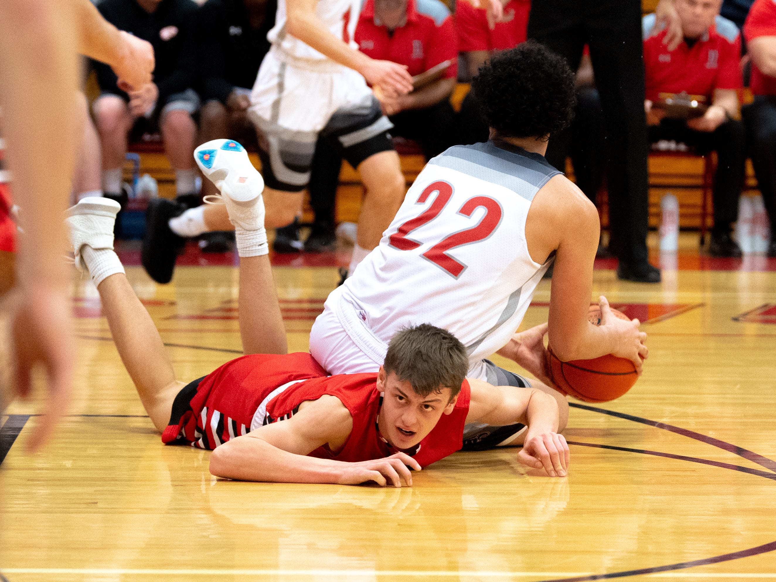 Gavin Held (2) of Susquehannock narrowly misses stealing the ball from Elijah Sutton (22) of Dover during the boys' basketball game, December 18, 2018. The Eagles defeated the Warriors 69-61.