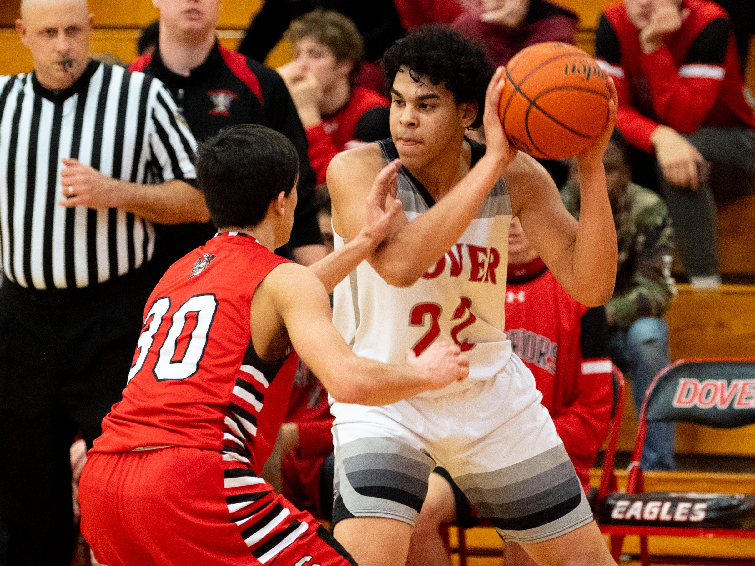 Dover's Elijah Sutton (22) scans the floor during the boys' basketball game between Dover and Susquehannock at Dover Area High School, December 18, 2018. The Eagles defeated the Warriors 69-61.