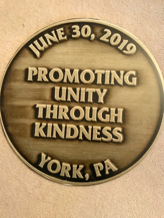 The back of the Kindness Coin, which entitles bearers to attend a 10,000-person unity dinner June 30, 2019 in York's Penn Park.