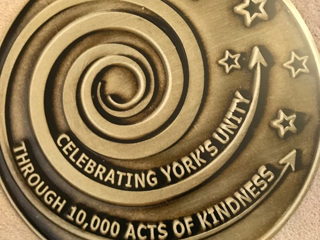The front of the Kindness Coin, which entitles bearers to attend a 10,000-person unity dinner June 30, 2019 in York's Penn Park.