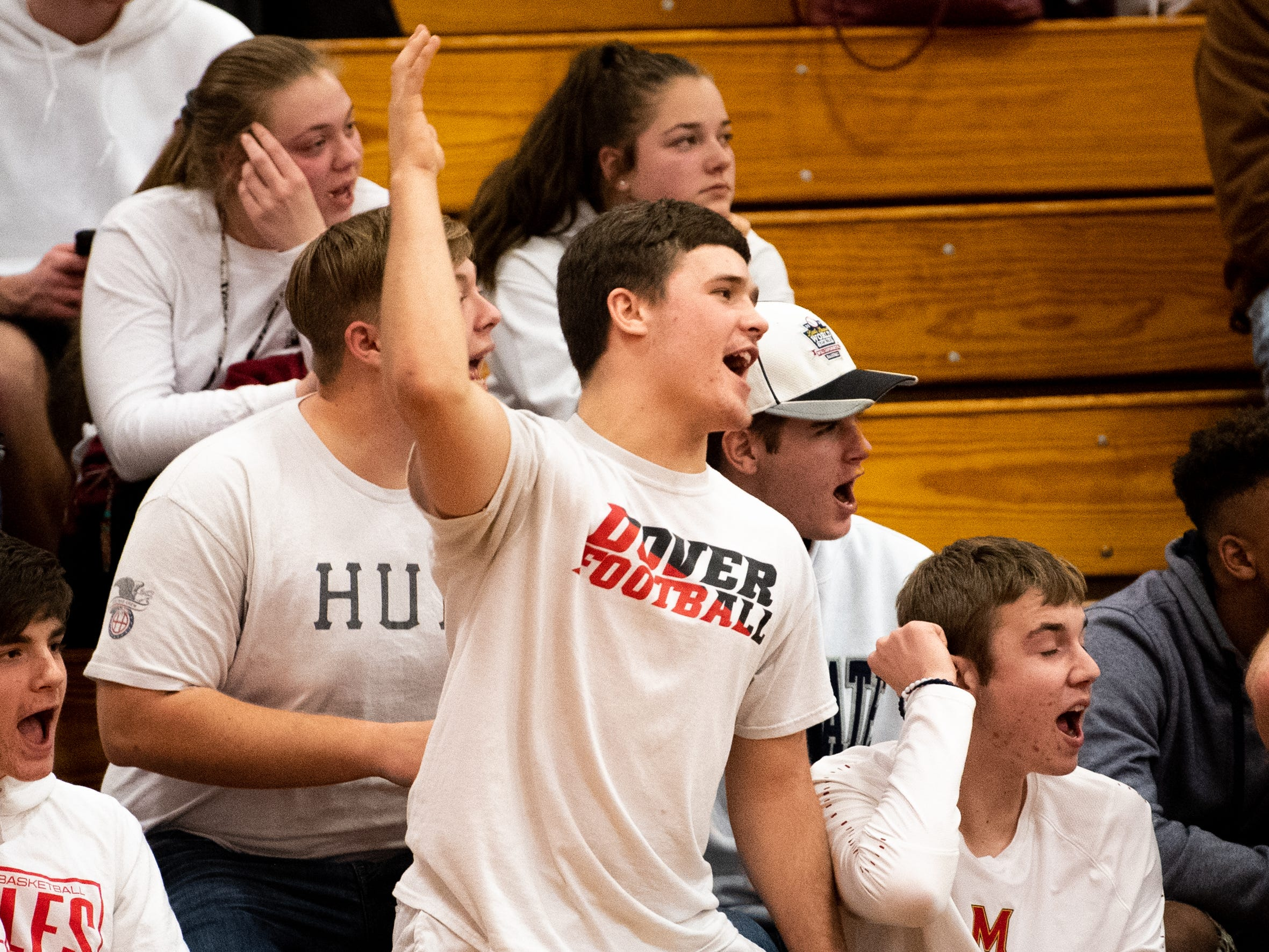 Dover's student section cheers on their team during the boys' basketball game against Susquehannock, December 18, 2018. The Eagles defeated the Warriors 69-61.