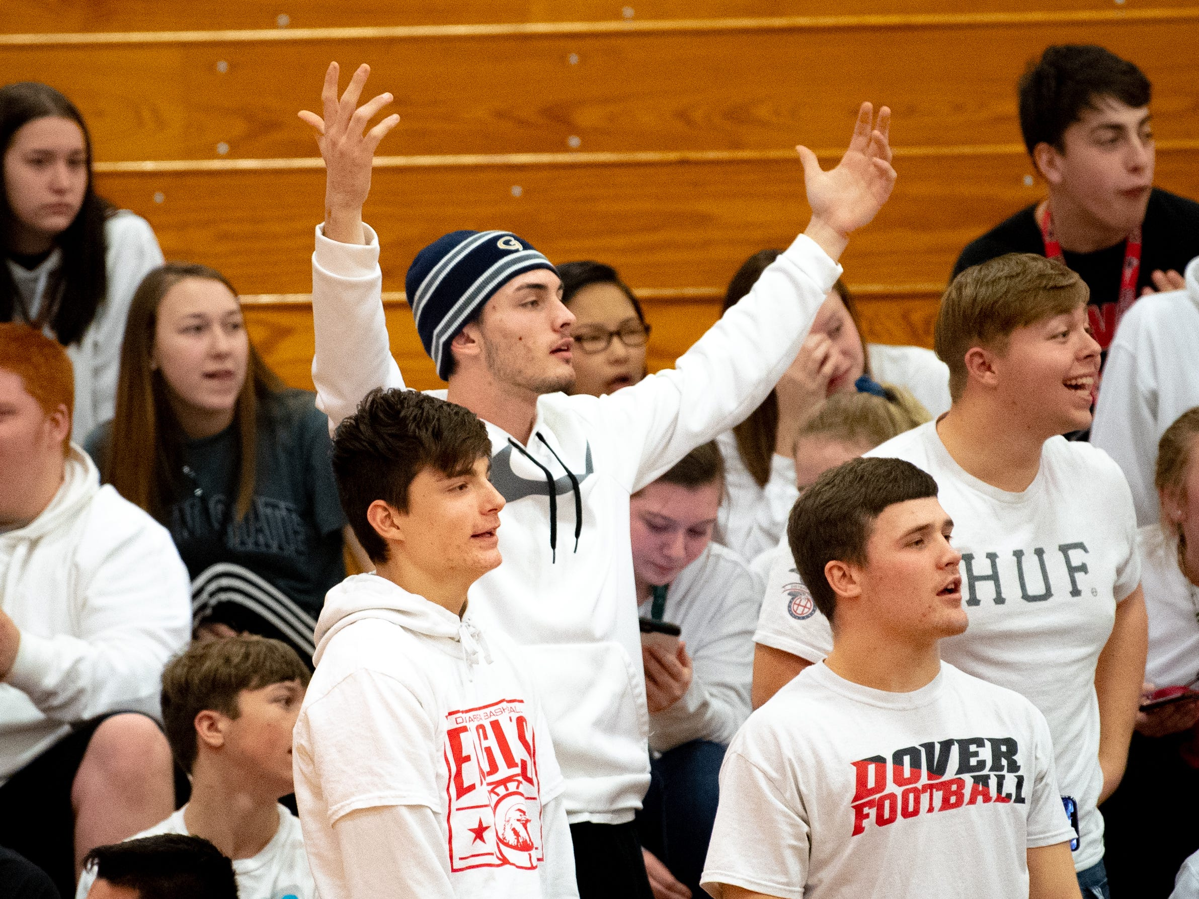 Dover's student section isn't happy with the travel call during the boys' basketball game between Dover and Susquehannock at Dover Area High School, December 18, 2018. The Eagles defeated the Warriors 69-61.