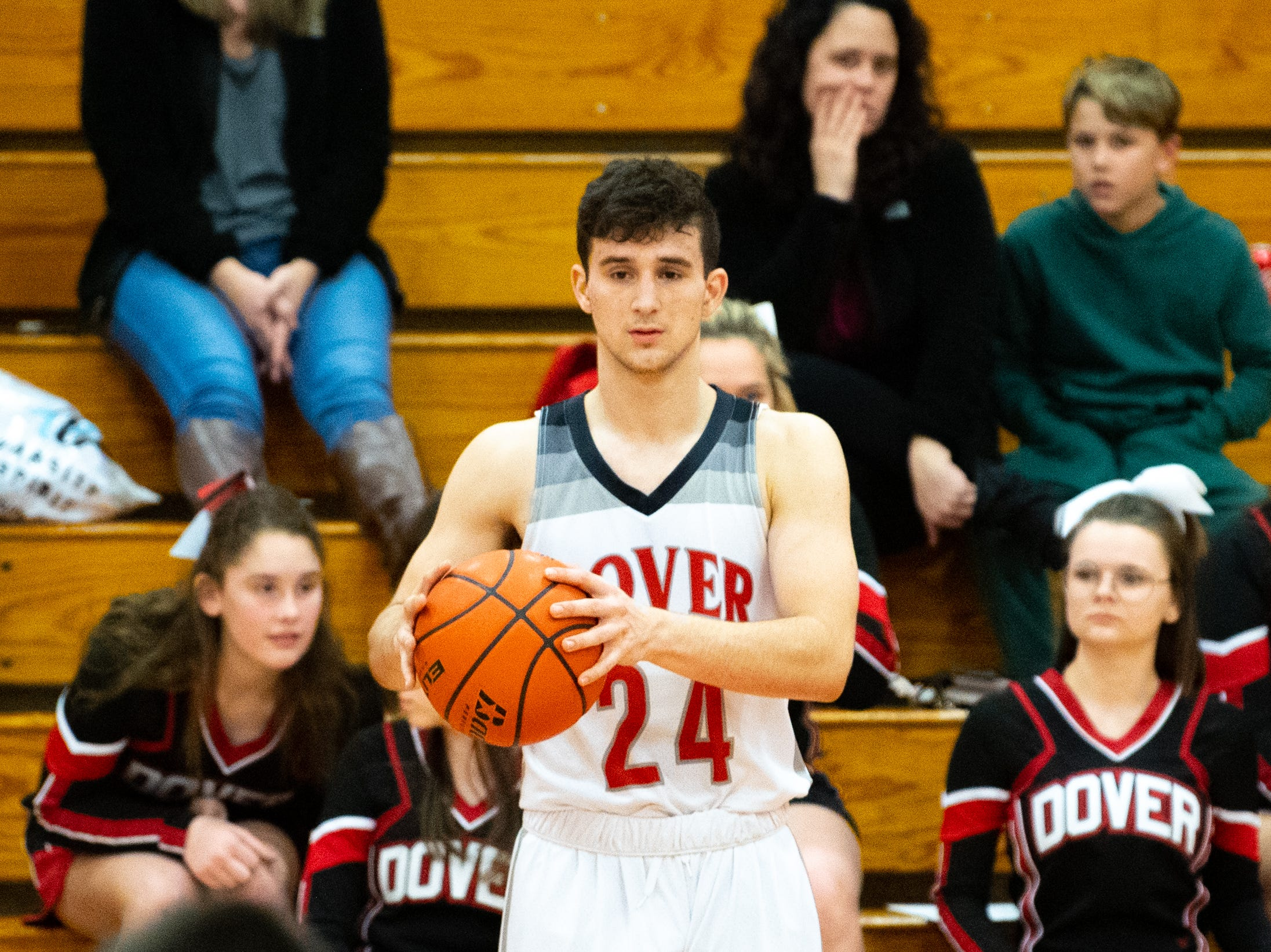 Adam Jovicevic (24) prepares to pass the ball in during the boys' basketball game between Dover and Susquehannock at Dover Area High School, December 18, 2018. The Eagles defeated the Warriors 69-61.