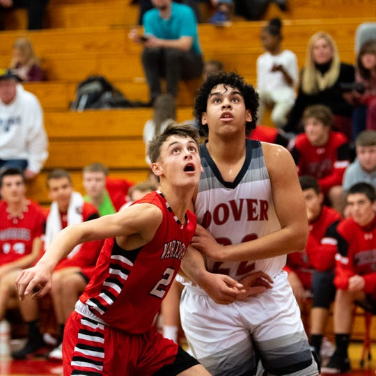 Gavin Held (2) of Susquehannock boxes out Dover's Elijah Sutton (22) during the boys' basketball game, December 18, 2018. The Eagles defeated the Warriors 69-61.