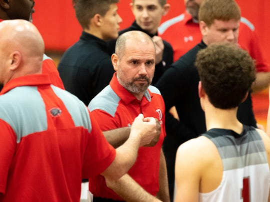 Dover head coach Brian Schmoyer comes upon with a game plan during the boys' basketball game between Dover and Susquehannock at Dover Area High School, December 18, 2018. The Eagles defeated the Warriors 69-61.