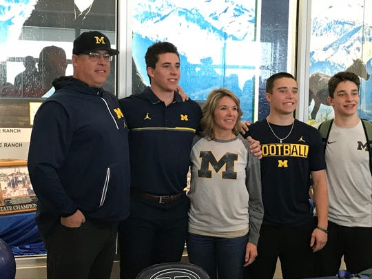 Damonte Ranch senior Cade McNamara, shown with his family Wednesday,  signed with Michigan for football in a ceremony at Damonte Ranch.