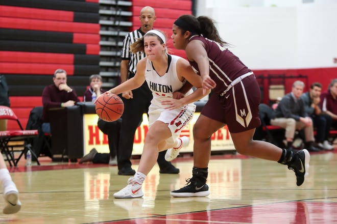 Hilton Cadets Olivia Strauss (14) dribbles the ball against Pittsford Mendon defender Lexi Green (20).