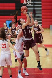Pittsford Mendon Vikings guard/forward Alana Fursman (21) attempts a layup against the Hilton Cadets in December of this season.